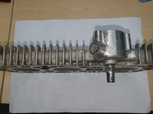 Cylinder head with slight corrosion visible