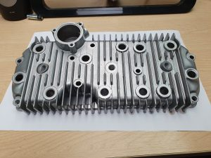 Vapour blasted cylinder head casting showing finished item
