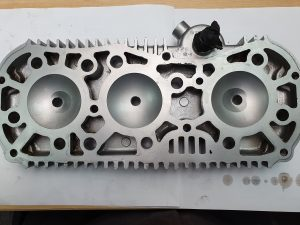 Vapour blasted cylinder head showing clean fluid galleries