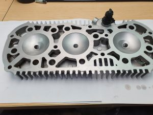 Vapour blasted cylinder head showing clean combustion chambers